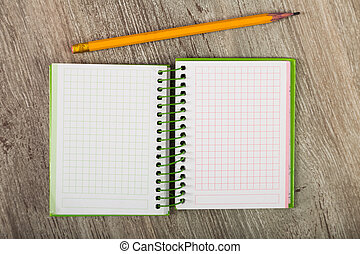 open notebook - Open notebook lying on wooden surface and ...