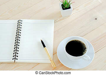 Open notebook with coffee cup