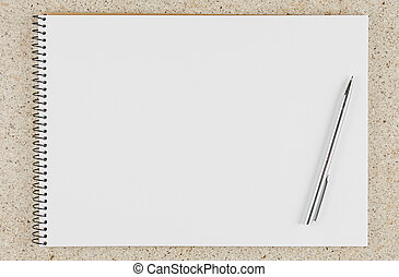 open notebook with pen on the table top view