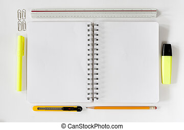 Open notebook with stationaries - Open notebook with various...