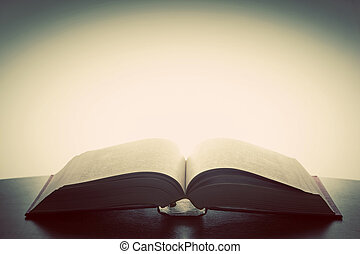 Open old book, light from above. Fantasy, imagination,...