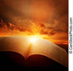 Open old book, light from sunset sky, heaven. Education, ...