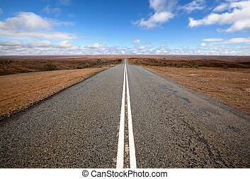 Open road in Australian outback. Mundi Mundi, west of Silverton, New South Wales. The horizon is so vast that you can see the curvature of the Earth.