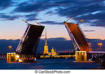 Open Palace Bridge and view of the Peter and Paul Fortress in St.Petersburg in white night