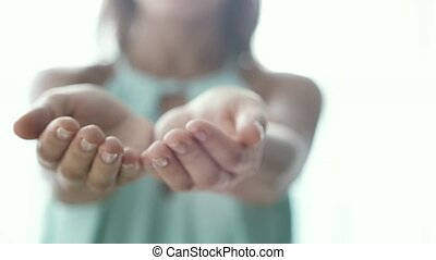 Open palms of female hands beckon. Gesture by young woman....