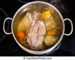 open pan with cooking beef broth with with seasoning ...