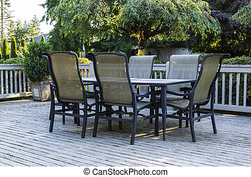 Open Patio during Summer - Open outdoor patio, table and...