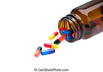 Open pharmaceutical bottle which spills colored capsules
