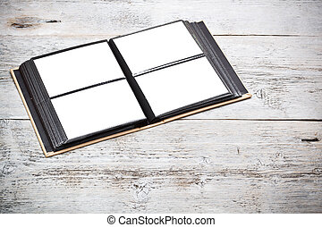 Open photo album with blank space
