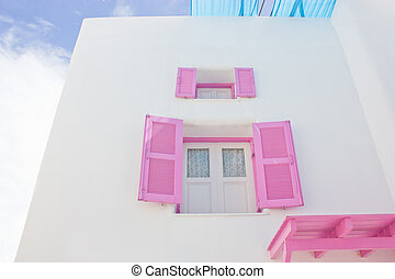 Open pink window with white building.