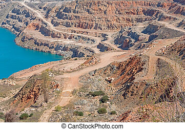 Open pit mine - Big open pit mine with a lake