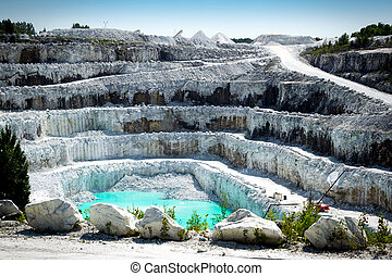 Open Pit White Marble Mine - View of the rocky layers of a...