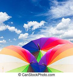 Open rainbow umbrellas