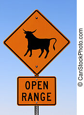 open range sign with livestock and a blue sky background