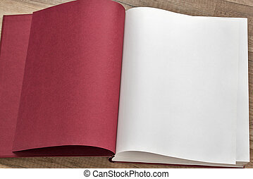 Open red book on the table