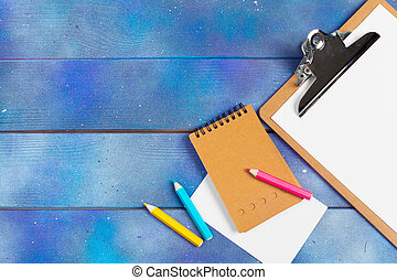 Open ring binder book on wood background