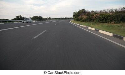open road - speeding down a highway