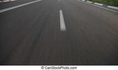speeding down a highway