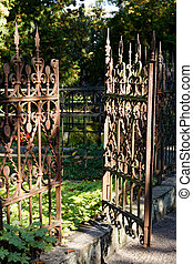 Open Rusty Iron Gate at Cemetery
