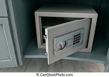 Open safe in a wealthy house. Safety box in hotel room....