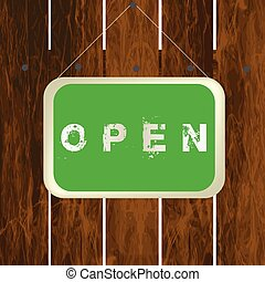 Open sign hanging on a wooden fence