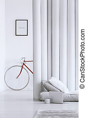 Open space bedroom design - Close-up of red bicycle standing...