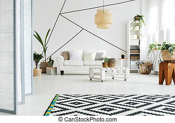 Open space in modern lounge with white walls and floor