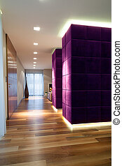 Open space interior with purple wall, vertical