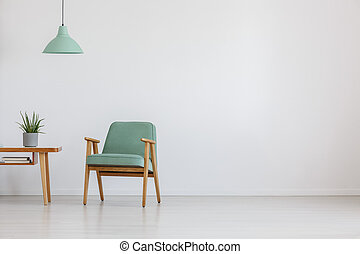 Open space with mint chair - Soft mint green chair in retro...