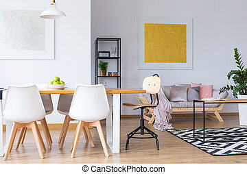 Open space with painting - Apples on dining table with white...