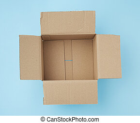open square empty cardboard brown box for packing and shipping things on a blue background