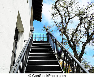 open staircase on side of building