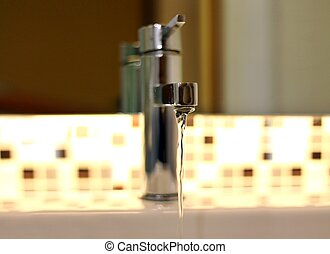 Open tap water with chrome faucet