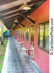 Open terrace with row of windows and doors in asian hotel