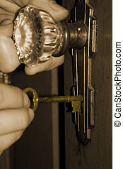 Open The Old Door - doorknob and old-fashioned key. Shallow...