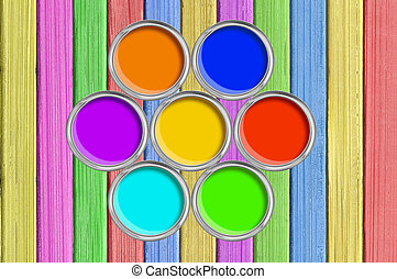open tin cans with paint on painted color wooden texture close-up