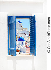 Open traditional Greek blue window on Santorini island,...