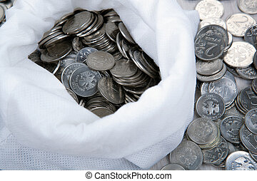 open white bag with russian ruble coins close up