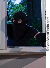 Open window and burglar