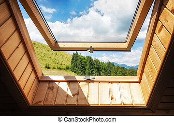 Open window at village wooden house in mountains