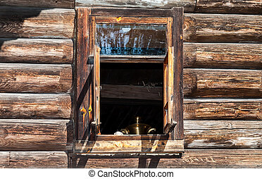 Open window in the old rural wooden house