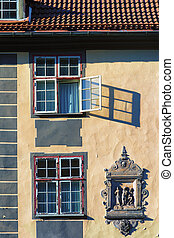Open window on the facade of an old house