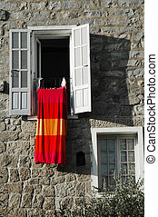 Open window with bedclothes