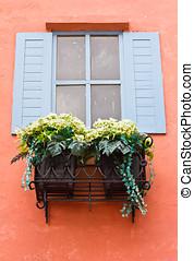 Open Window With Flower Basket On Orange Wall
