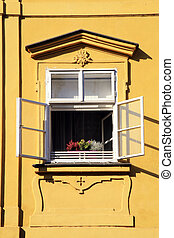 Open window with flowers in Old town of Prague, Czech Republic