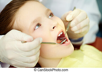 Open your mouth - Patient with opened mouth being examined...