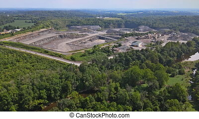 Opencast mining quarry for the extraction of in the middle of the forest on of Pennsylvania, USA
