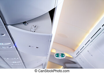 Opened airplan storage above the seat.