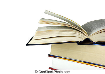 Opened book laying on other books isolated on white. Clipping path.