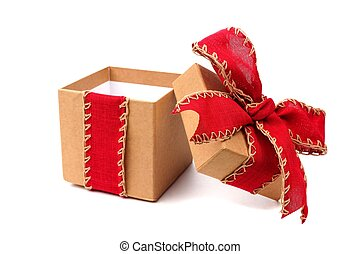 Opened brown gift box with red bow and ribbon isolated on white